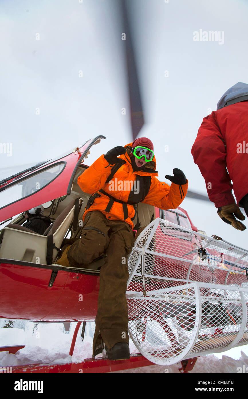 Austin Granger heli-snowbaording at Mica Creek Heli,Mica Creek,BC,Canada - Stock Image