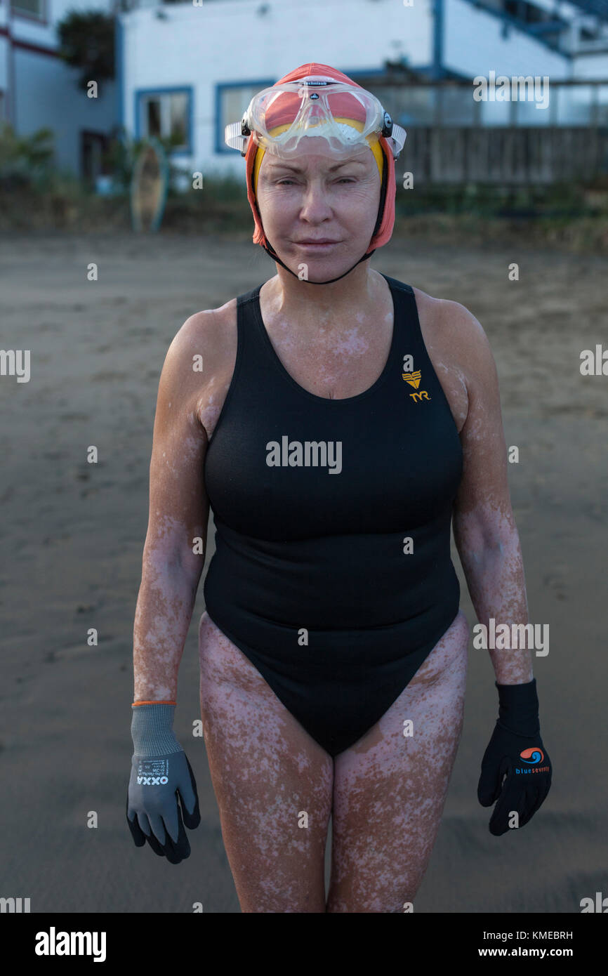 front view of woman in swimsuit and swimming cap, Dolphin Club, San Francisco, California, USA - Stock Image