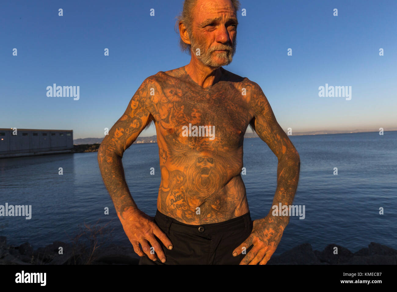 Portrait of homeless man at Warm Water Cove Park, San Francisco, California, USA - Stock Image