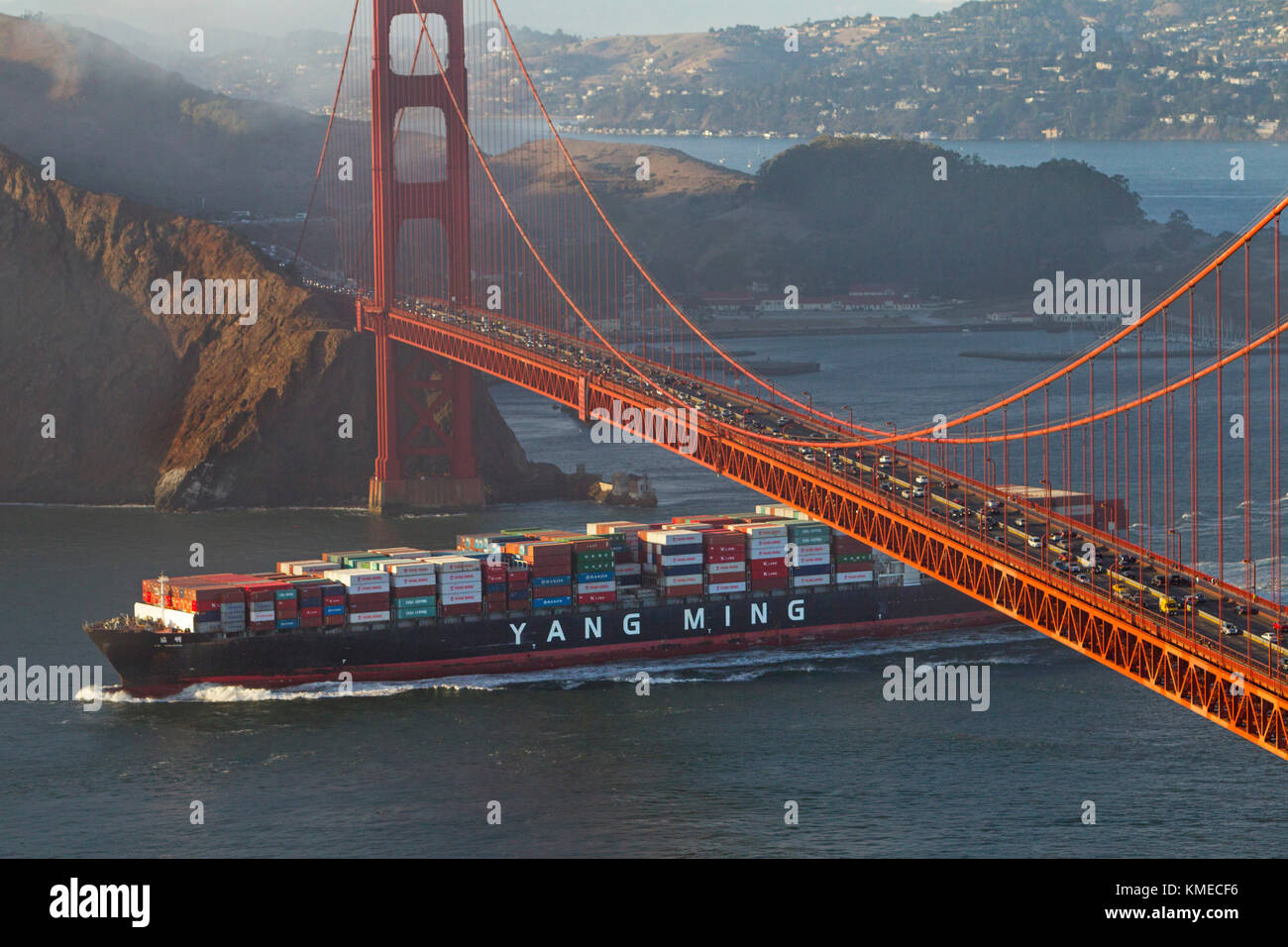 Freighter sailing under Golden Gate Bridge in San Francisco Bay, San Francisco, California, USA - Stock Image