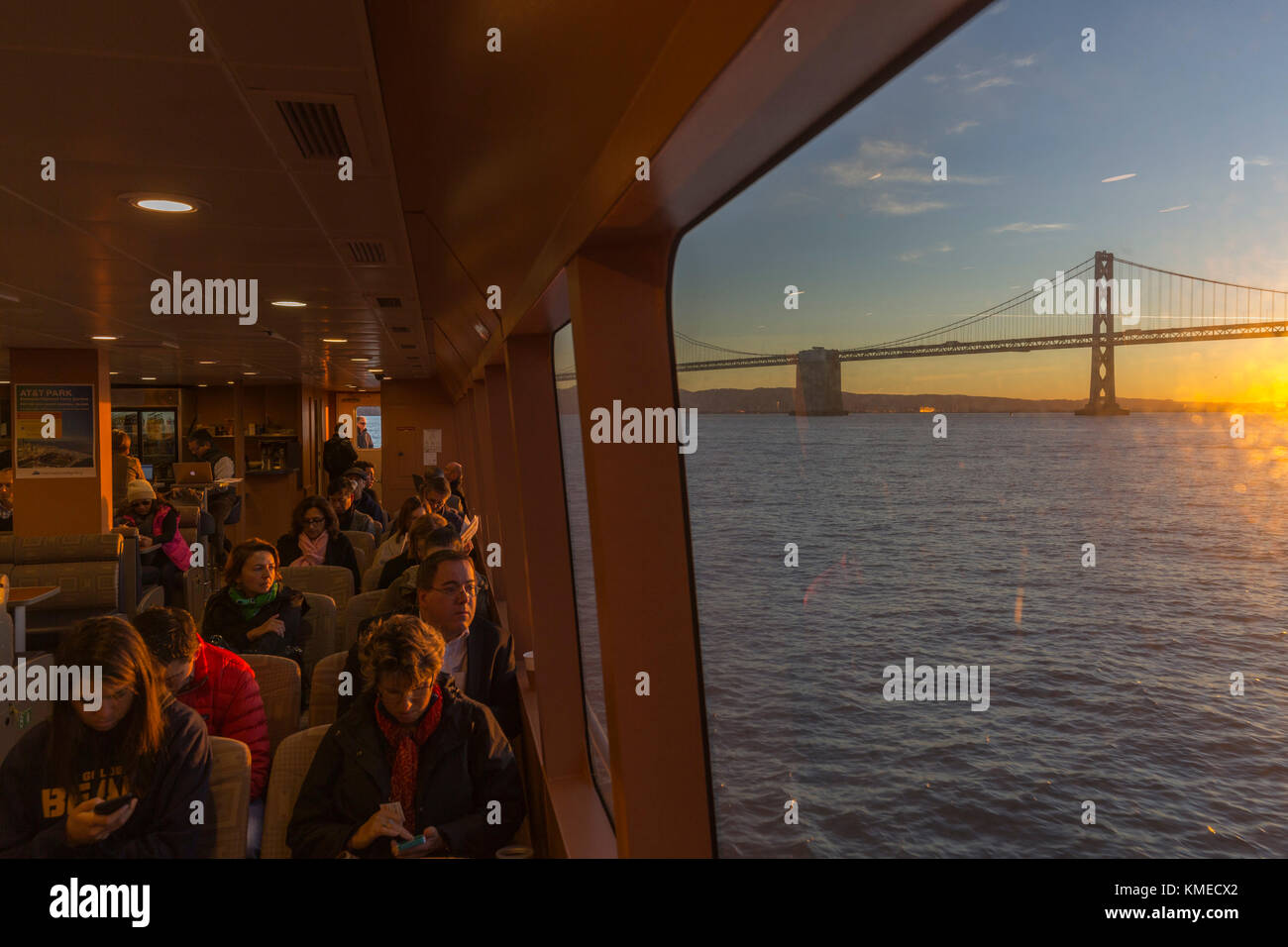 Passengers in commuter ferry from Tiberon to San Francisco Ferry Building,California,USA - Stock Image