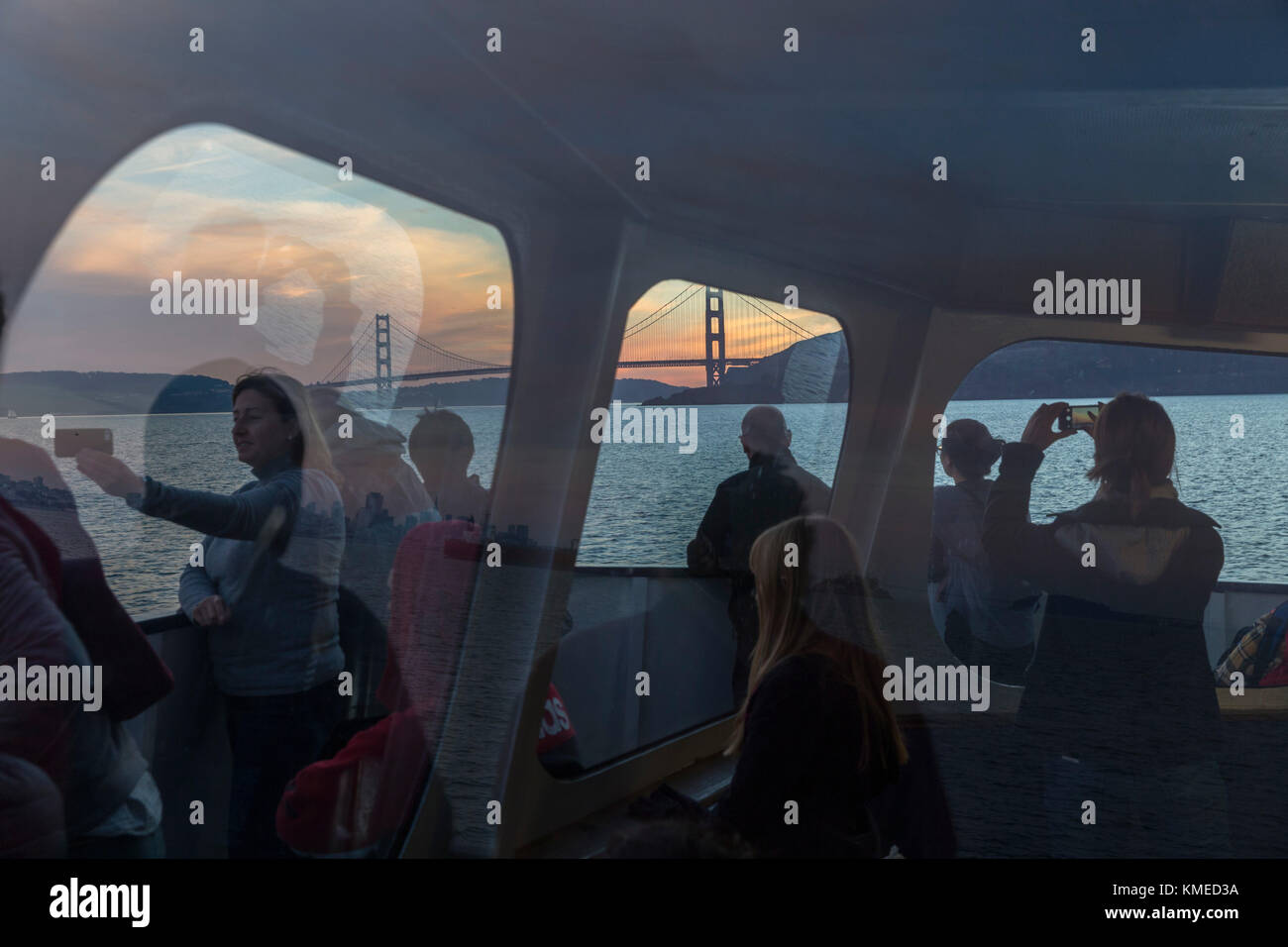 Passengers on ferry from Sausalito to San Francisco and Golden Gate Bridge in background,California,USA - Stock Image