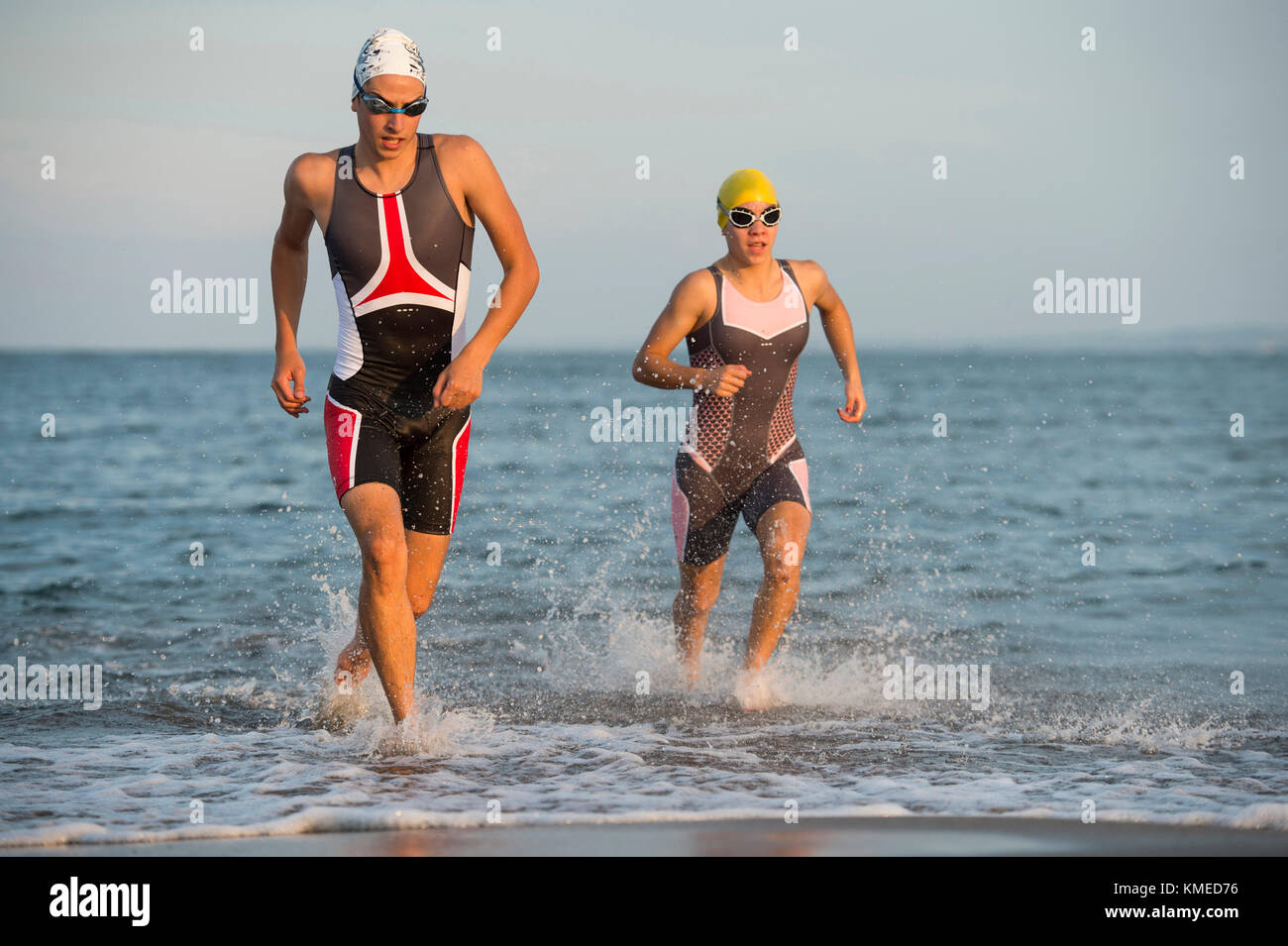Two athletes running out of water during triathlon race,Veracruz,Mexico - Stock Image
