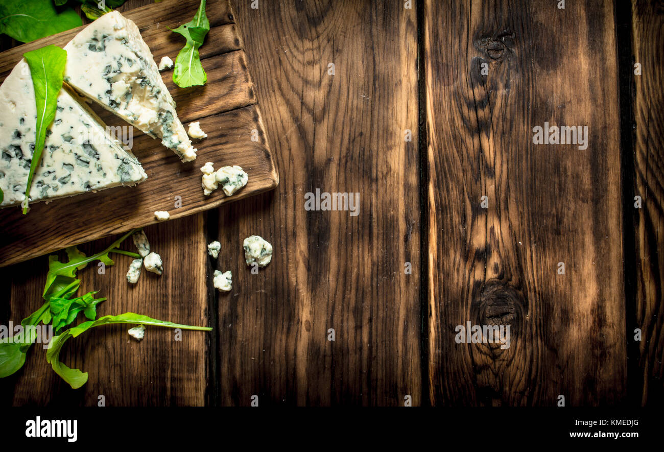 Italian cheese and herbs on the Board. - Stock Image