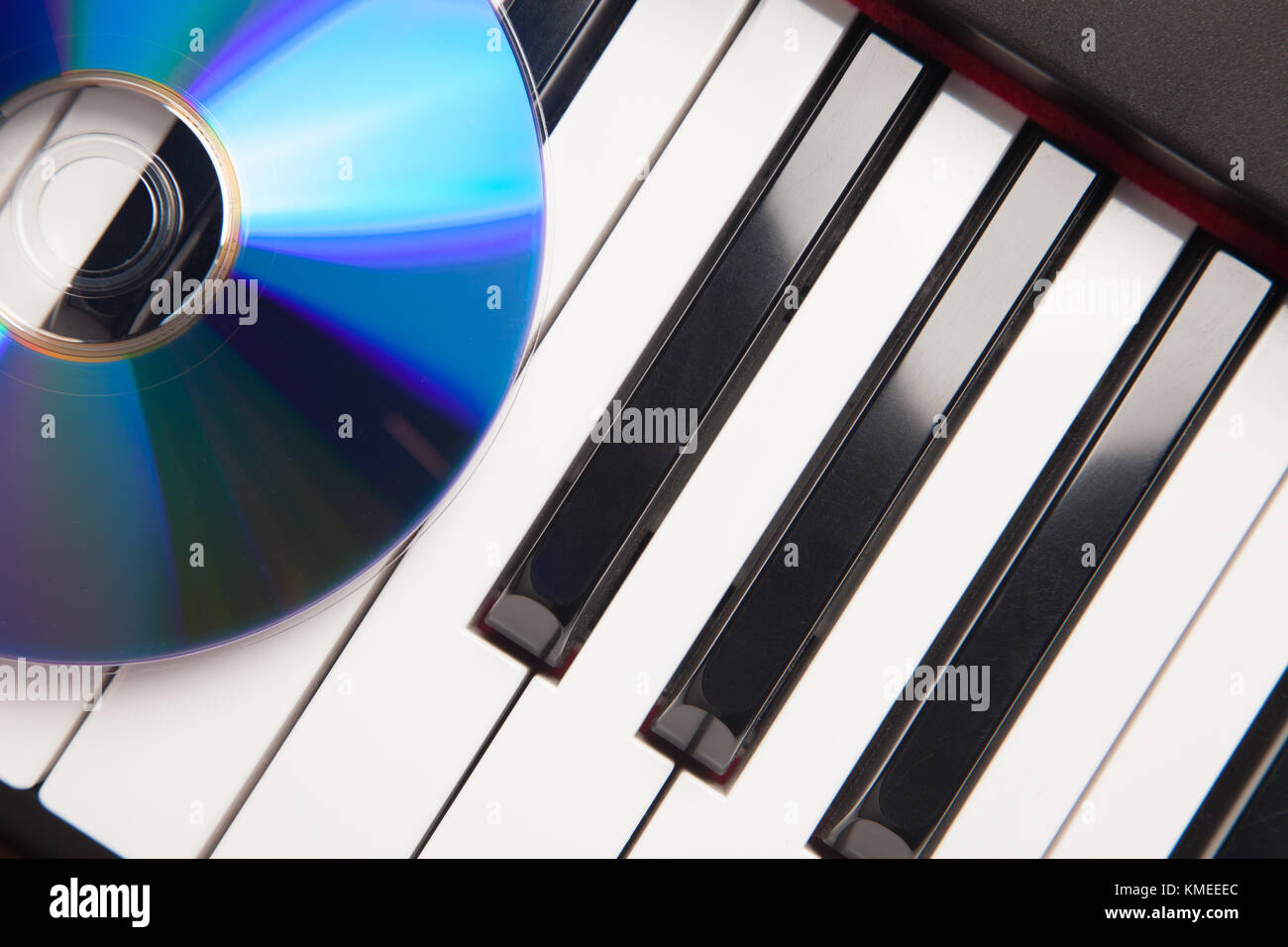 CD Laying on Piano Keyboards Abstract. - Stock Image