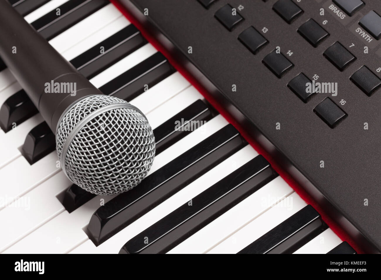 Microphone Laying on Electronic Synthesizer Keyboard Abstract. - Stock Image
