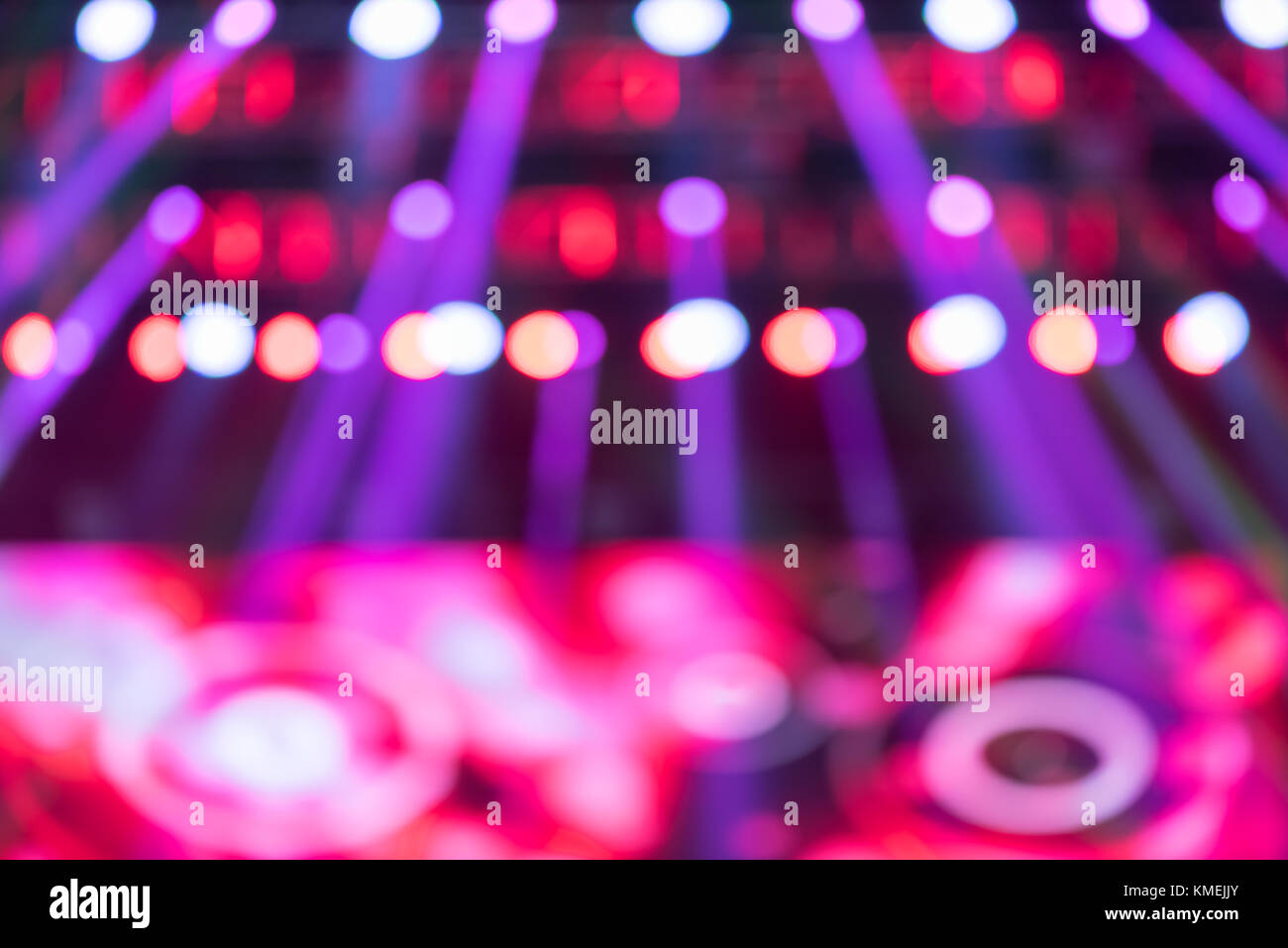 Music live show purple lights blurred background - Stock Image