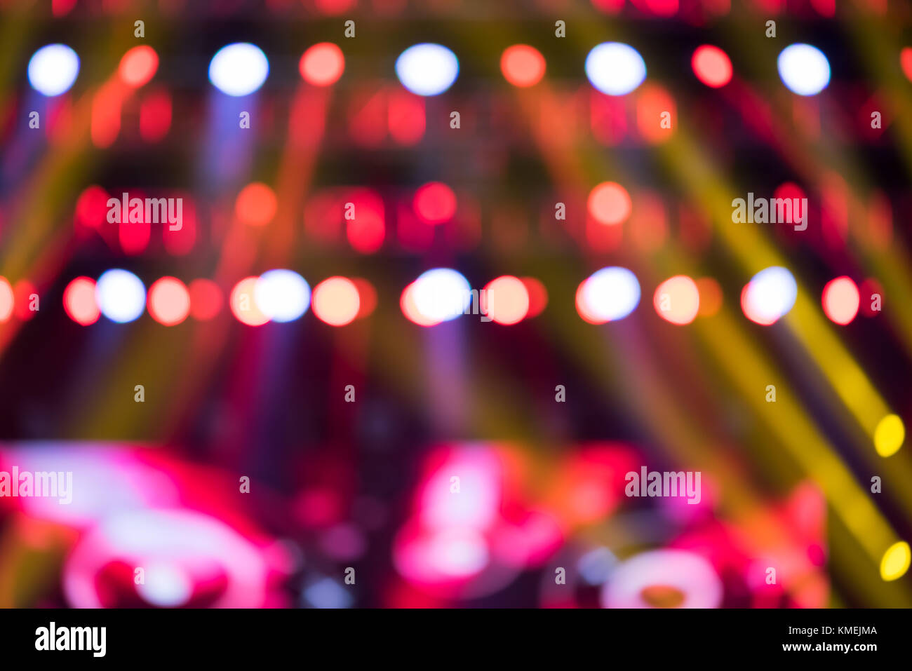 Music live show multicolor lights blurred background - Stock Image