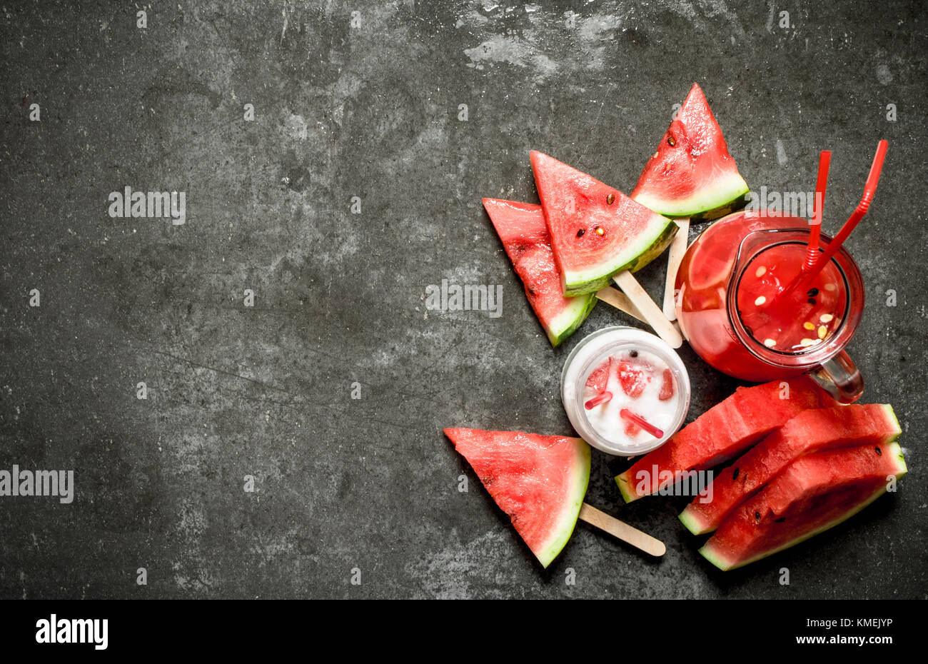 Watermelon smoothies and juice with pulp. On the stone table. - Stock Image