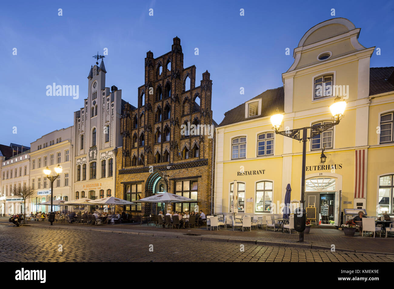 Pavement Cafes in front of old warehouse Alter Schwede, Wismar, Germany Stock Photo