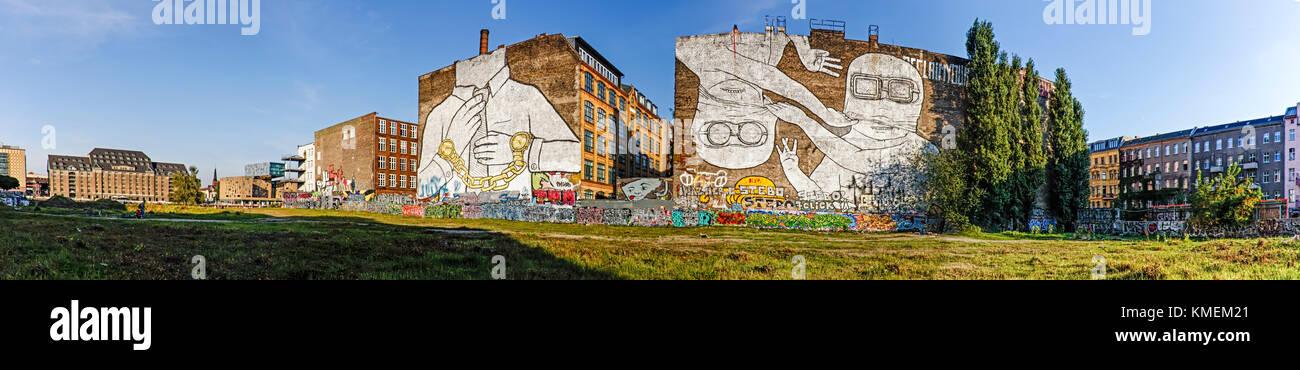 Panorama of Mural on firewall in Kreuzberg by italian artist Blu , Berlin, Germany - Stock Image