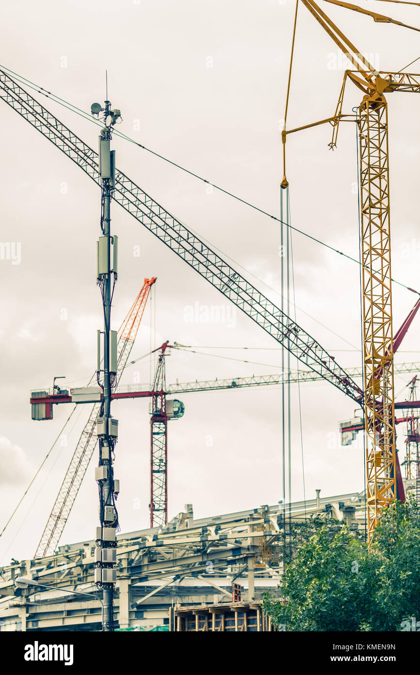 Crains on construction site of building Stock Photo