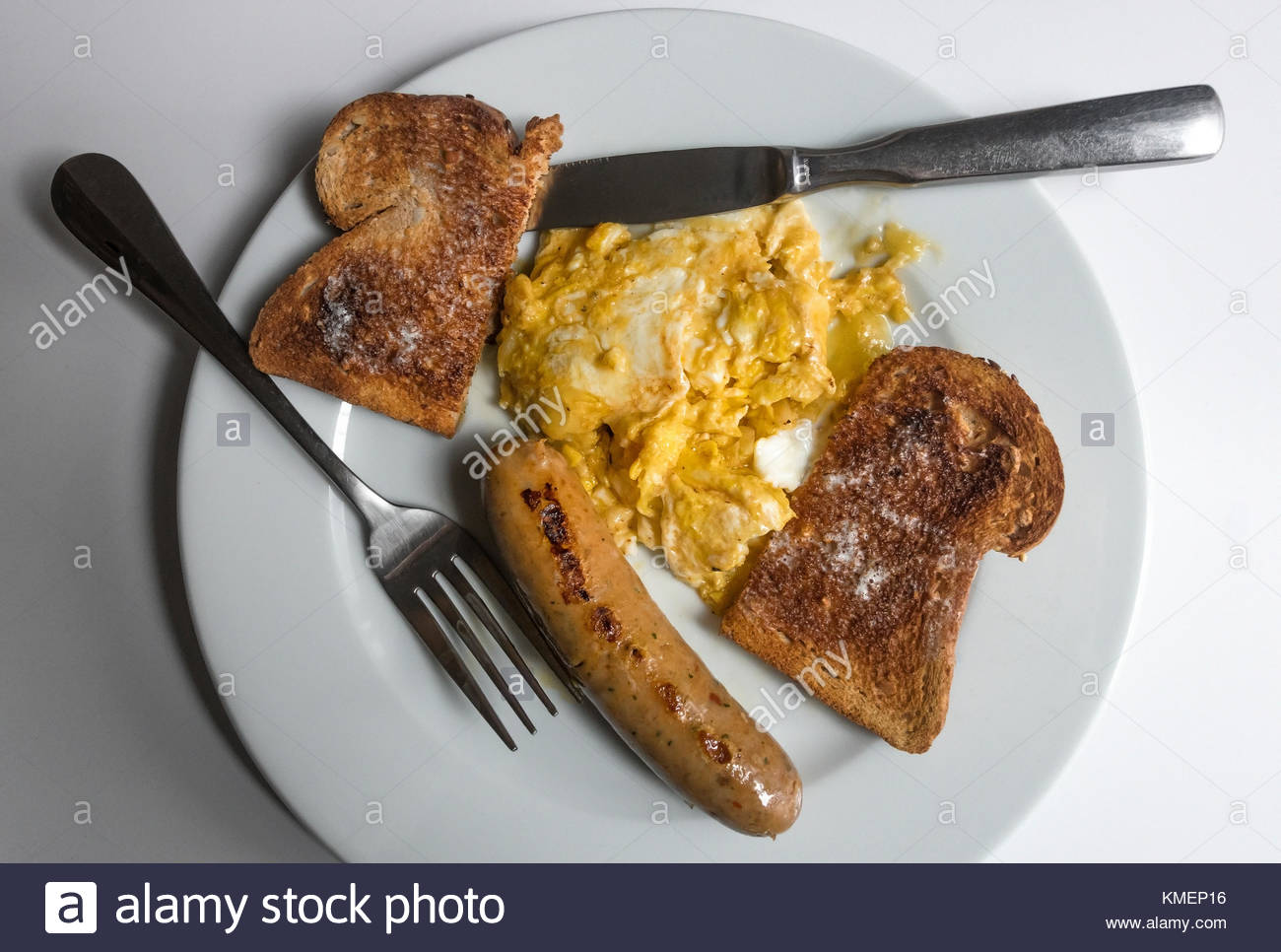 Scrambled Eggs With Cheese A Sausage And Whole Wheat Toast
