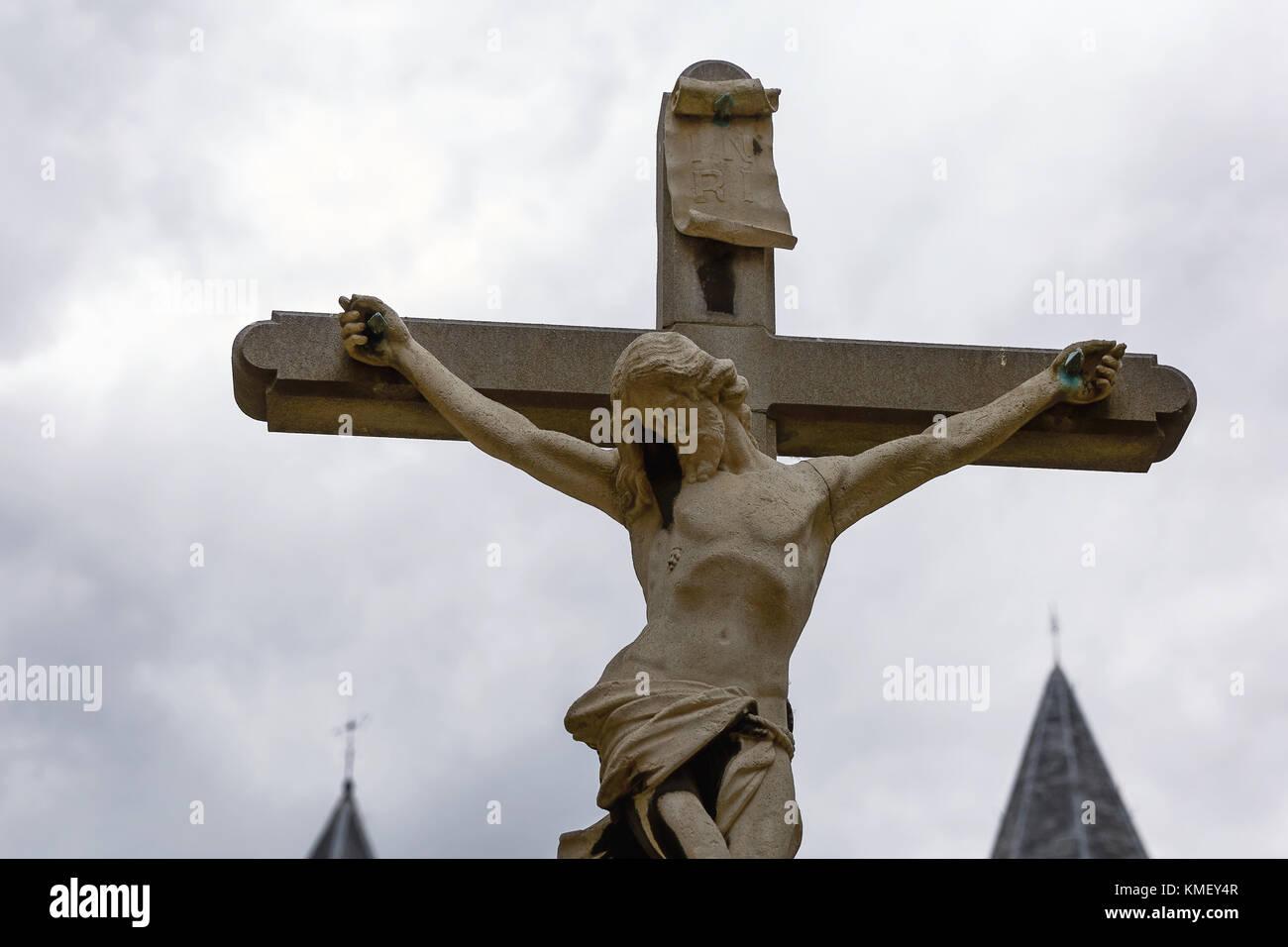 Jesus Christ crucified stone sculpure in Antwerp in Belgium. - Stock Image