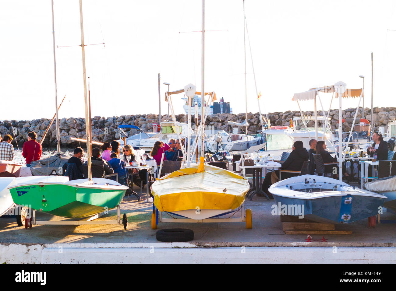 PALMA, SPAIN - DECEMBER 6, 2017: People sitting in one of the restaurants in Portixol marina. Palma, Majorca, Spain - Stock Image