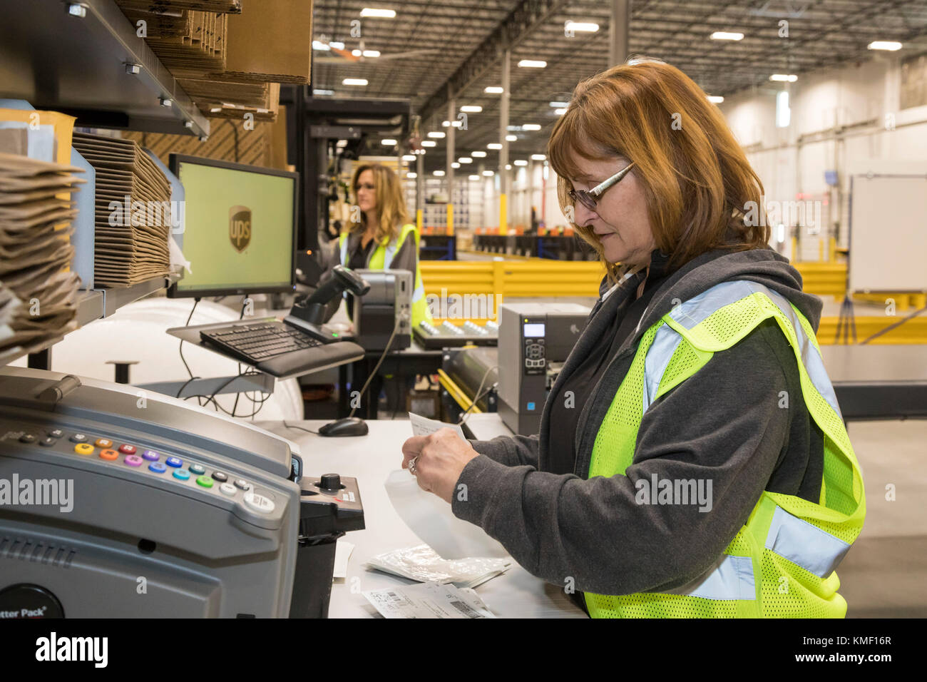 Romulus, Michigan - Workers prepare labels for UPS shipments at a Mopar auto parts distribution center. Mopar is - Stock Image