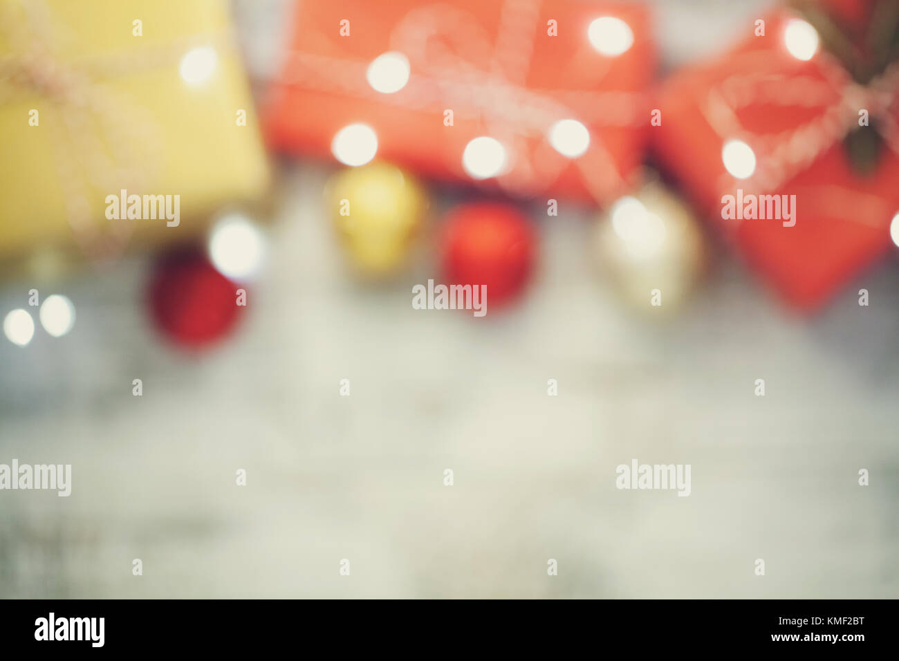 Abstract blur Christmas boxes with gifts, Christmas decorations and garlands for background use. vintage tones. - Stock Image
