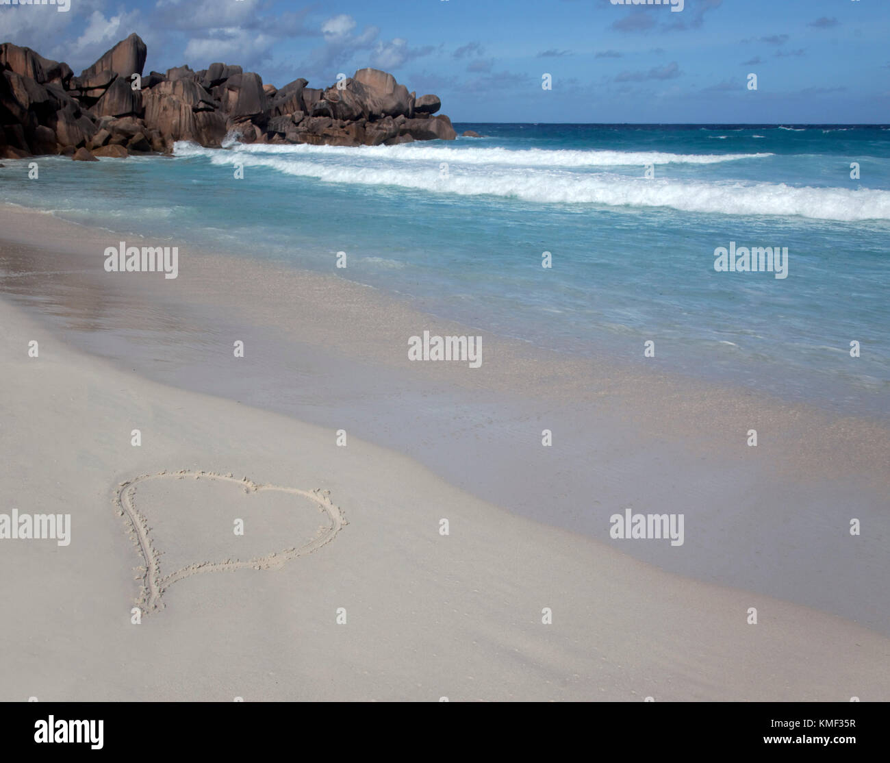 Heart written in sand,  Grand Anse beach ,  East Coast,  La Digue, Seychelles, Indian Ocean, Africa - Stock Image