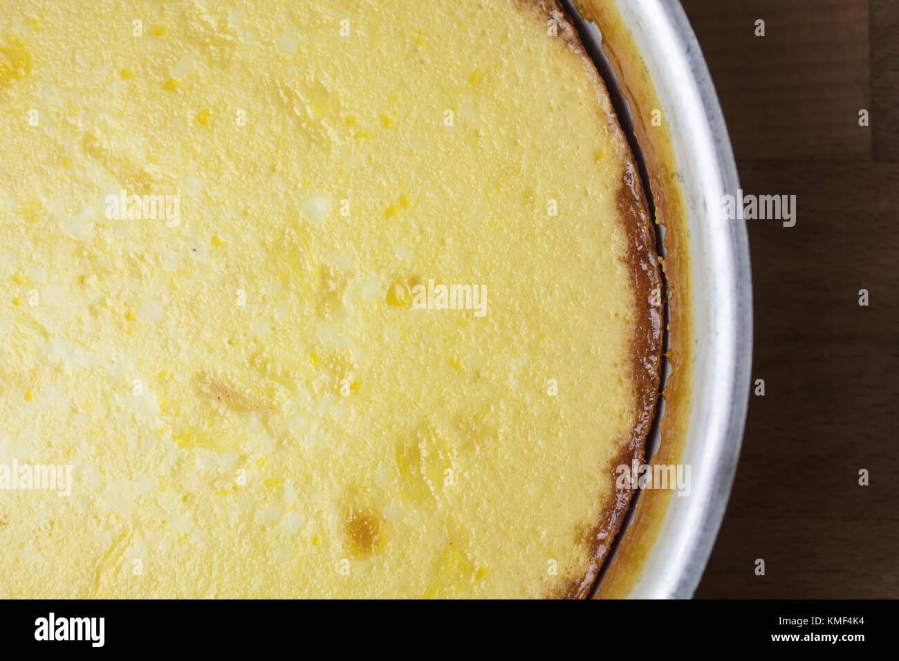 Process of making an egg flan dessert for baking - Stock Image