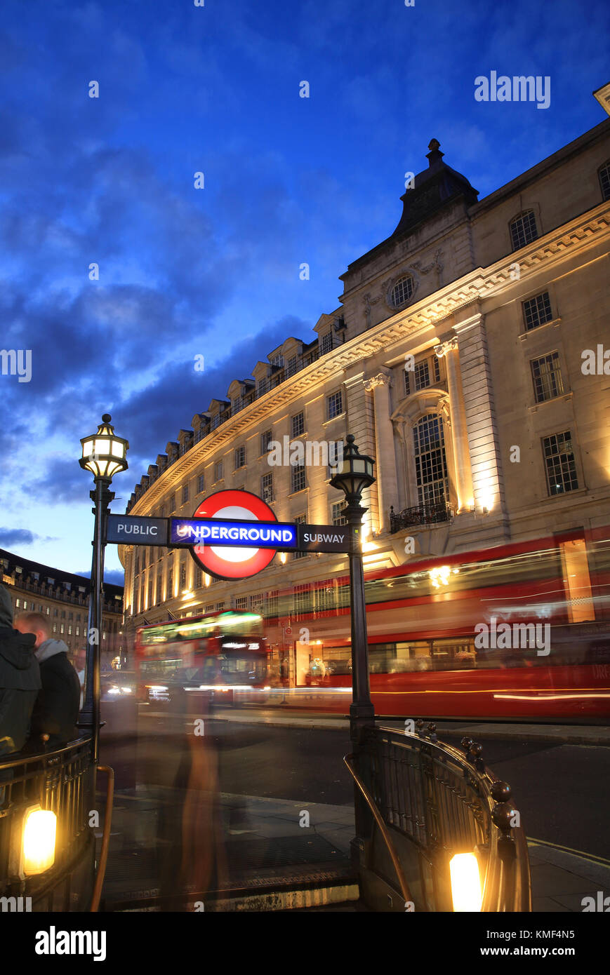 Red buses on Regent Street at dusk, by Piccadilly Circus, in central London, England, UK - Stock Image