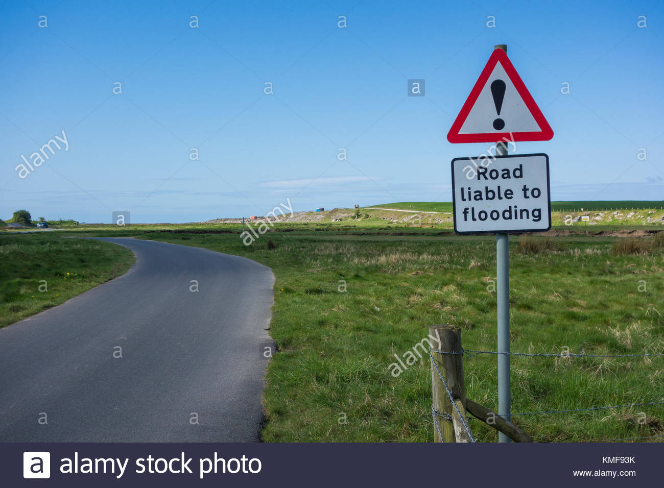 A warning sign indicating that the road is liable to flloding at high tide, on marshland near to Carnforth on the Stock Photo