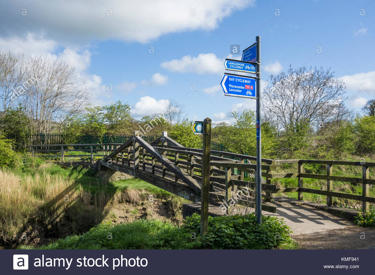 Bay Cycleway and Lancashire Cycleway sign by a bridge near Carnforth in Lancashire, on NCN routes 6, 90 and 700 - Stock Image