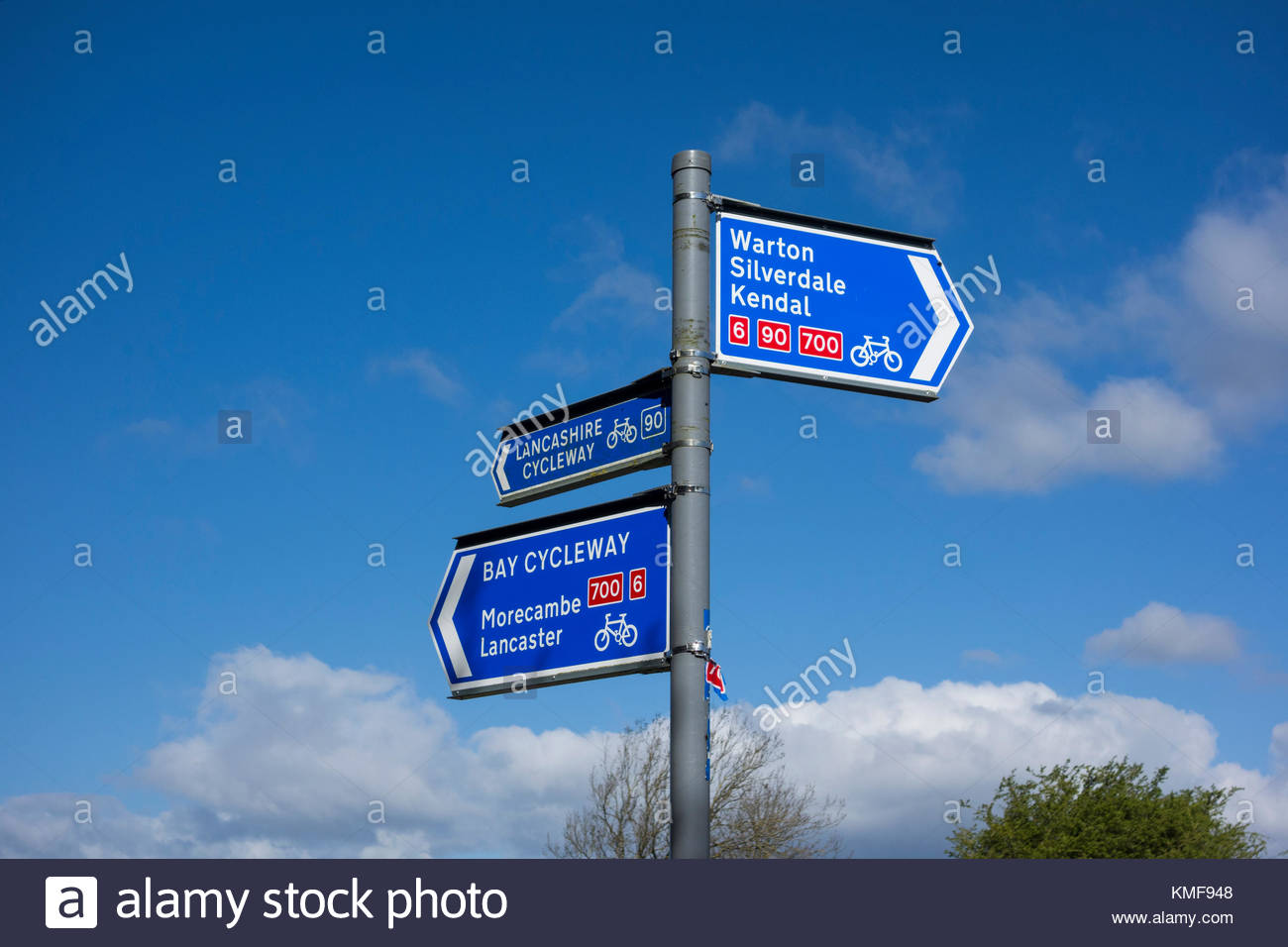 Bay Cycleway and Lancashire Cycleway sign near Carnforth in Lancashire, on NCN routes 6, 90 and 700 - Stock Image