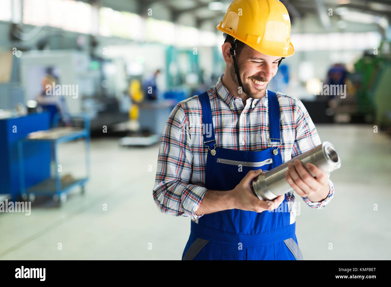 Portrait of an metal engineer working at factory - Stock Image