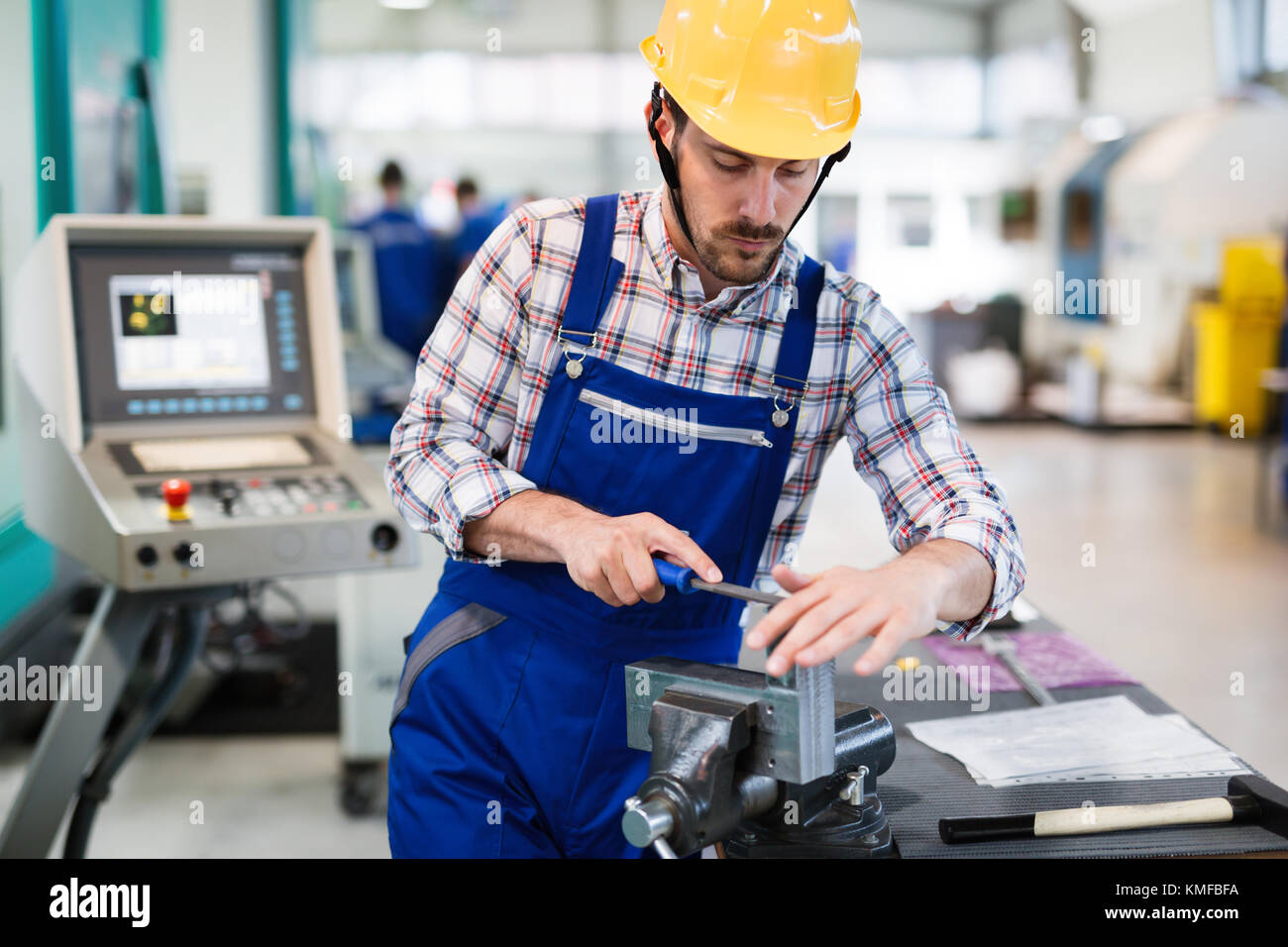industrial factory employee working in metal manufacturing industry - Stock Image