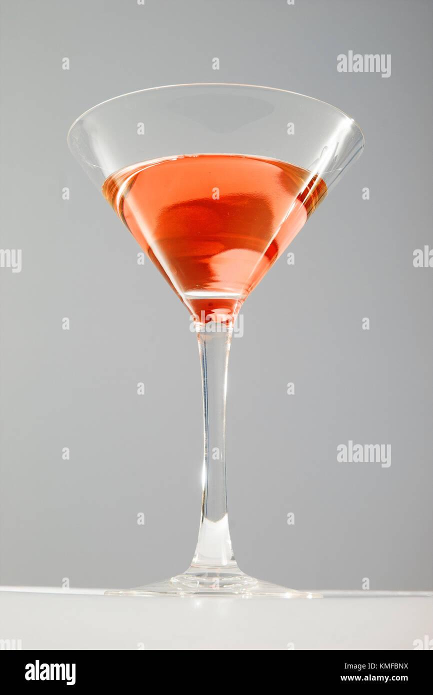 Cosmopolitan cocktail martini glass studio photo. Fashion cocktails. - Stock Image