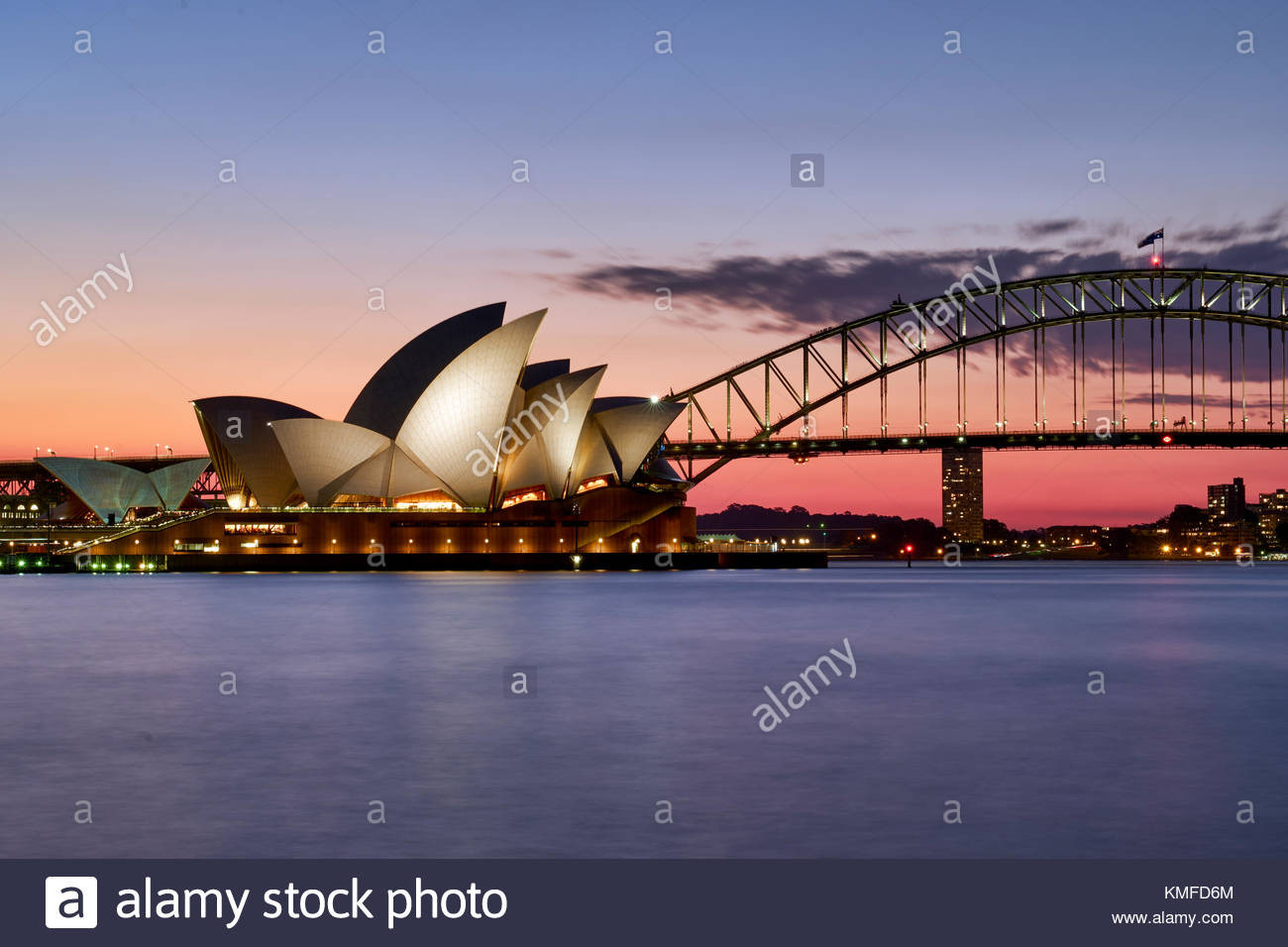 The Sydney Opera House and Harbour bridge at sunset. Sydney, Australia - Stock Image
