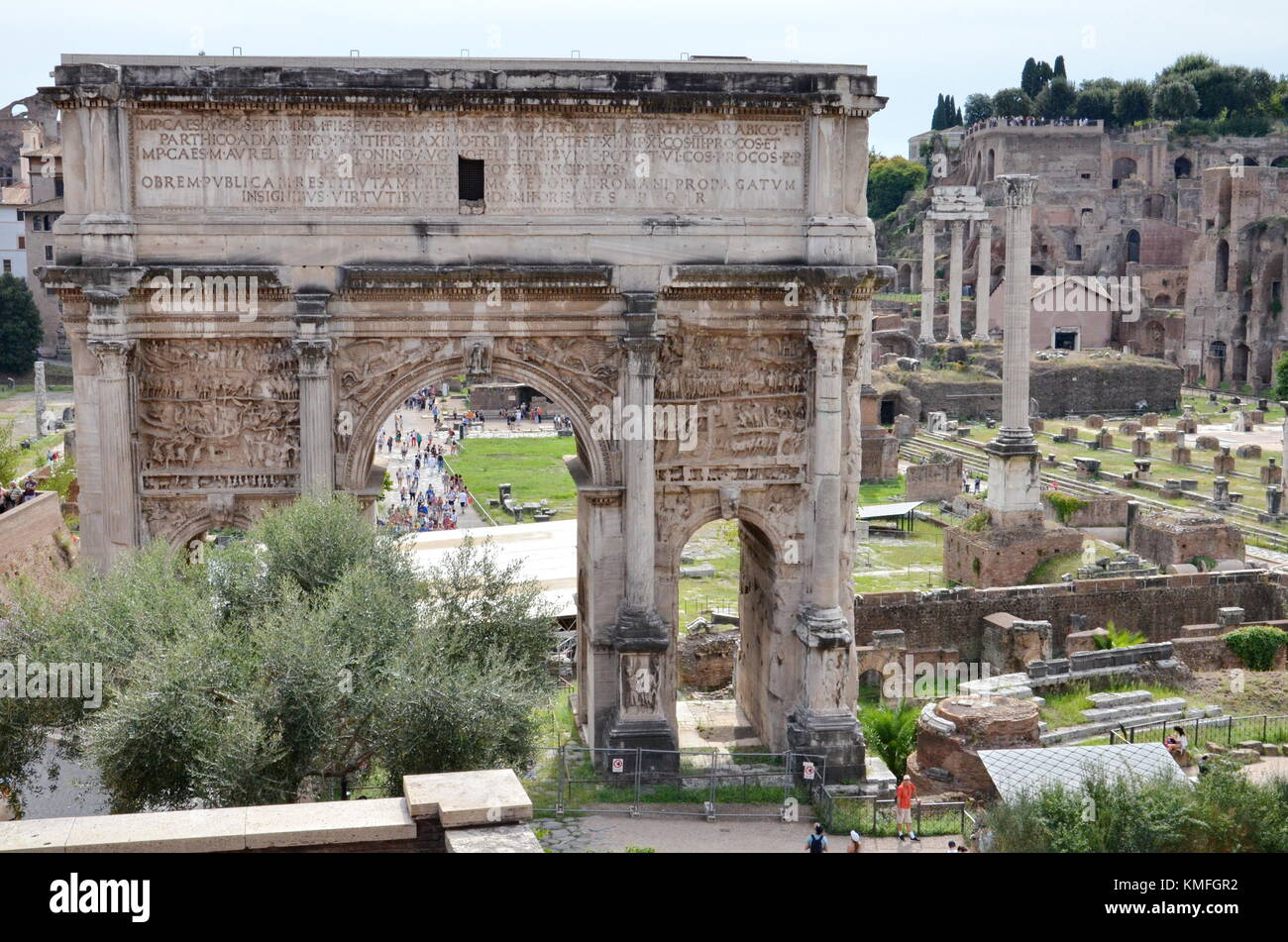 Rome, Italy - September 9, 2015: Tourists visit the Arch of Septimius Severus located in the Roman Forum in Rome, - Stock Image