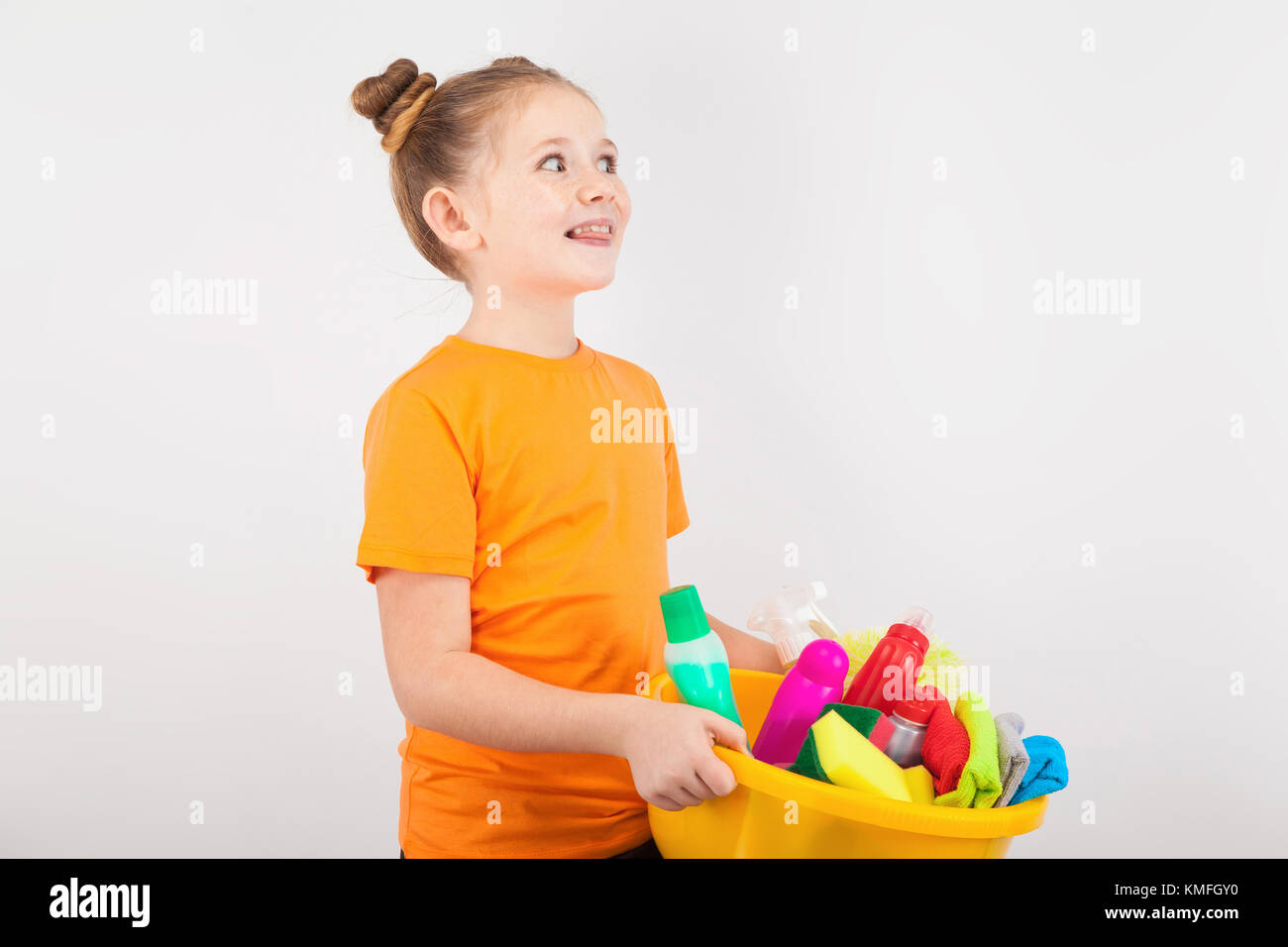 a little pretty girl doing housework - Stock Image