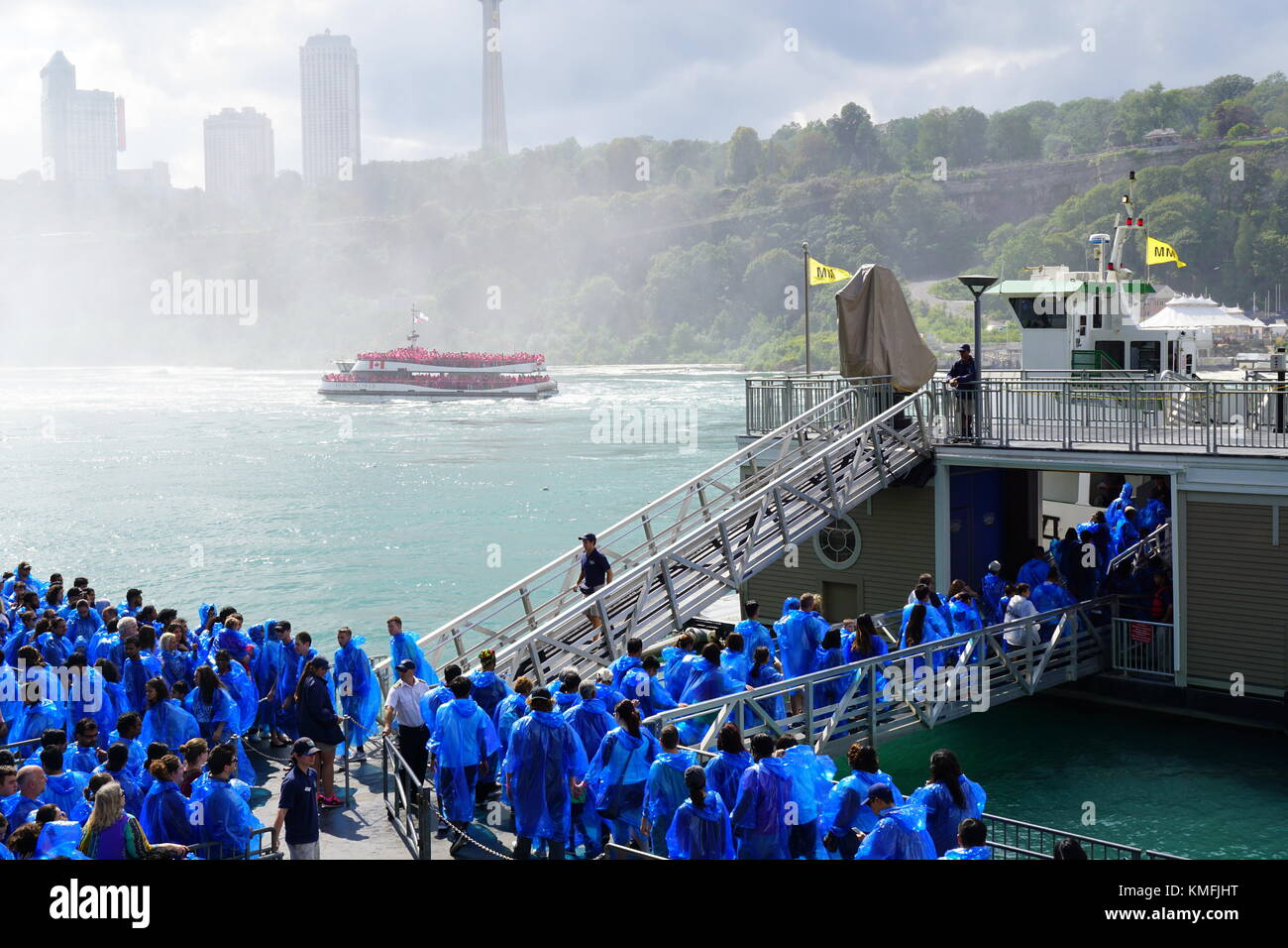 Visitors (tourists) boarding the Maid of the Mist ferry boat at Niagara Falls, New York, USA Stock Photo
