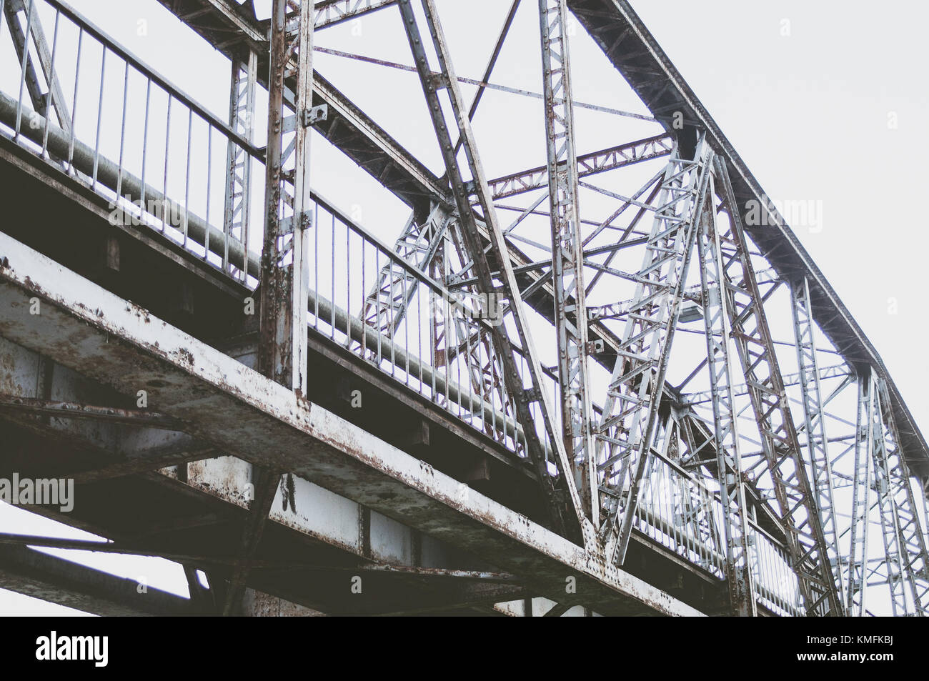 Railway bridge constructions from the bottom. Stock Photo