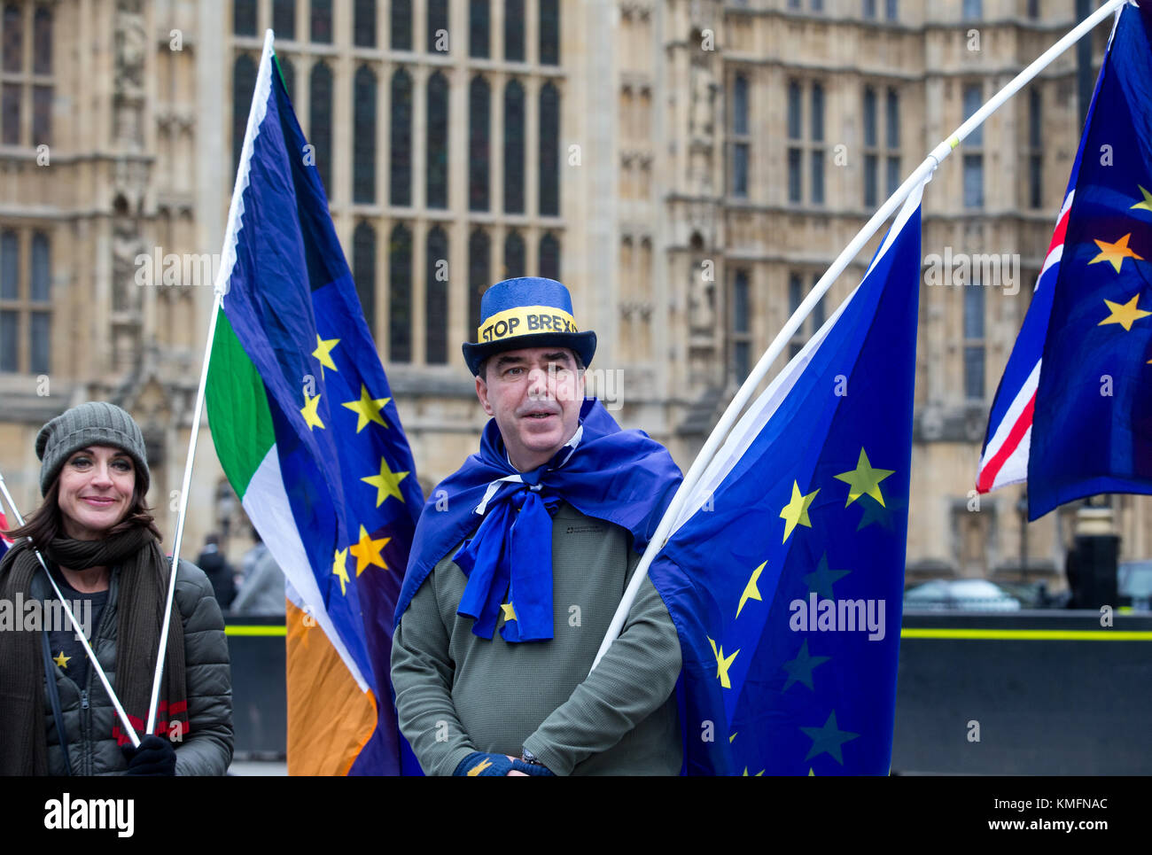 Pro EU Supporters wave European Union and Union Jack and Irish flags outside the Houses of Parliament in London, - Stock Image