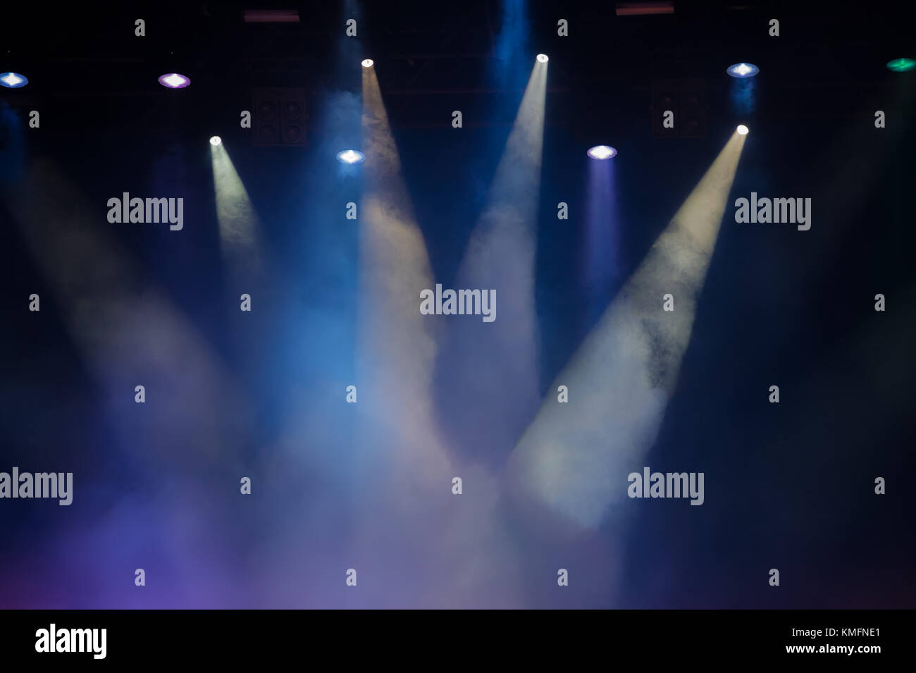 Concert stage. Beautiful Colourful disco lighting in the stage. Performance moving lighting. Concert Light Show. - Stock Image