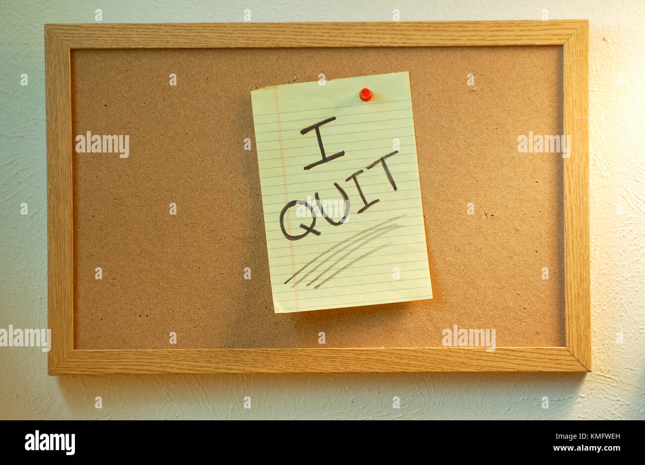 Bulletin Board with Handwritten Note Saying 'I Quit' - Stock Image