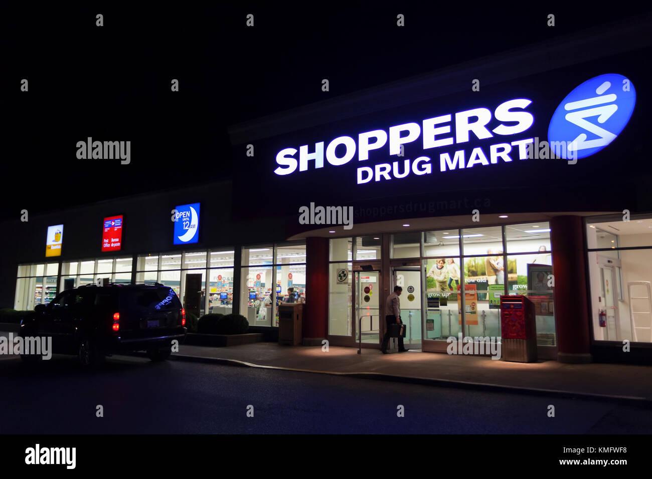 Toronto, Canada - Oct 19, 2017: Shoppers Drug Mart store in the city of Toronto illuminated at night Stock Photo