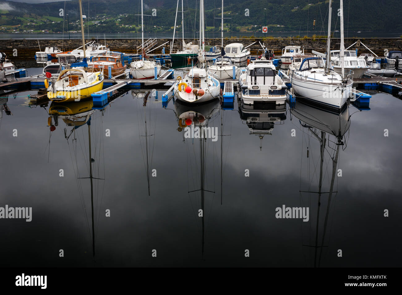 Yacht reflection in lake, Norway - Stock Image