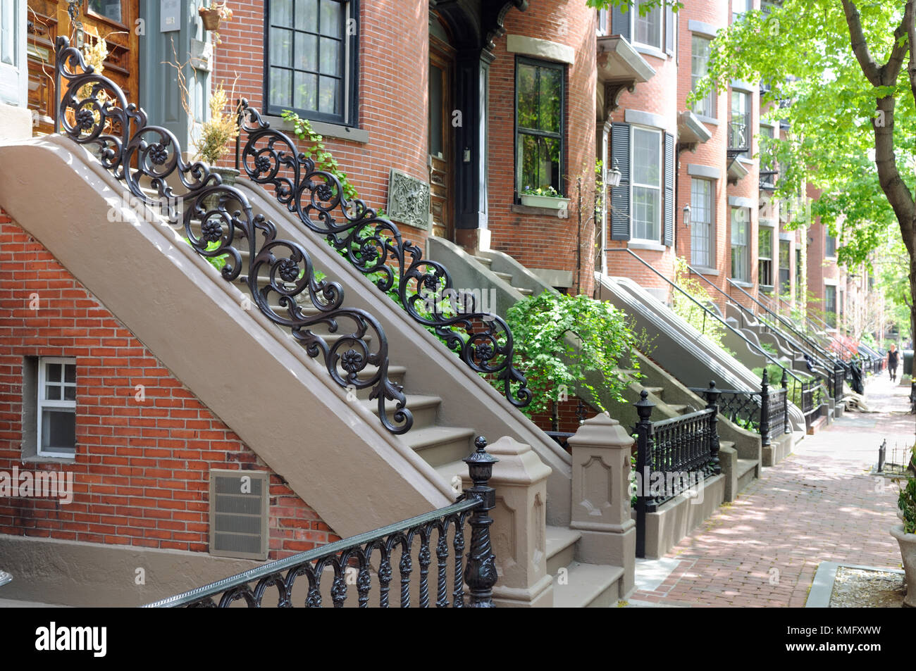 Townhouse Apartments In Boston South End. Brick Sidewalk, Stone Steps, Iron  Fences And Railings With Running Rose Patterns.