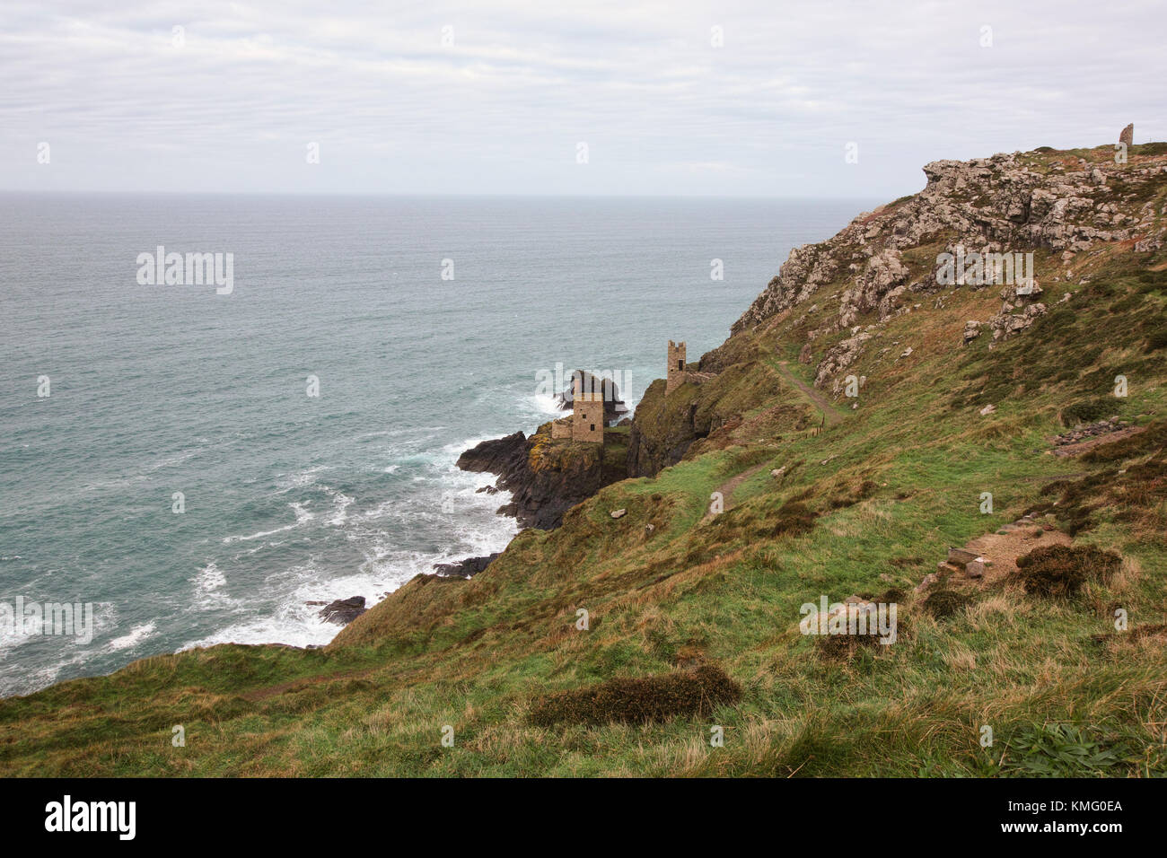 An ancient tin mine Botallack sits on the edge of a cliff in Cornwall in the South east of England. - Stock Image