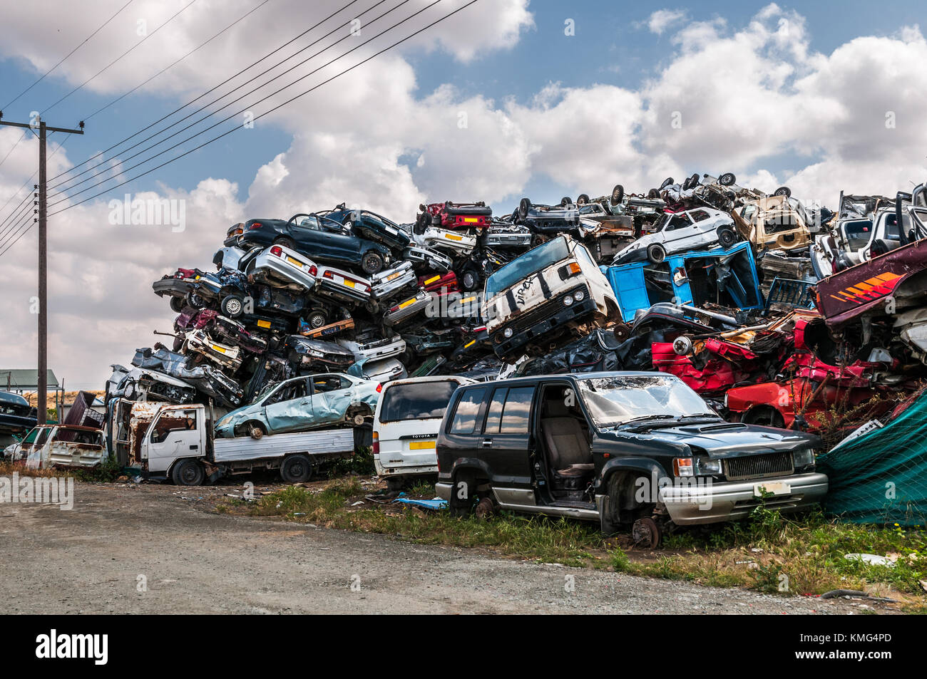Used abandoned cars stacked for recycling in a scrap metal facility ...