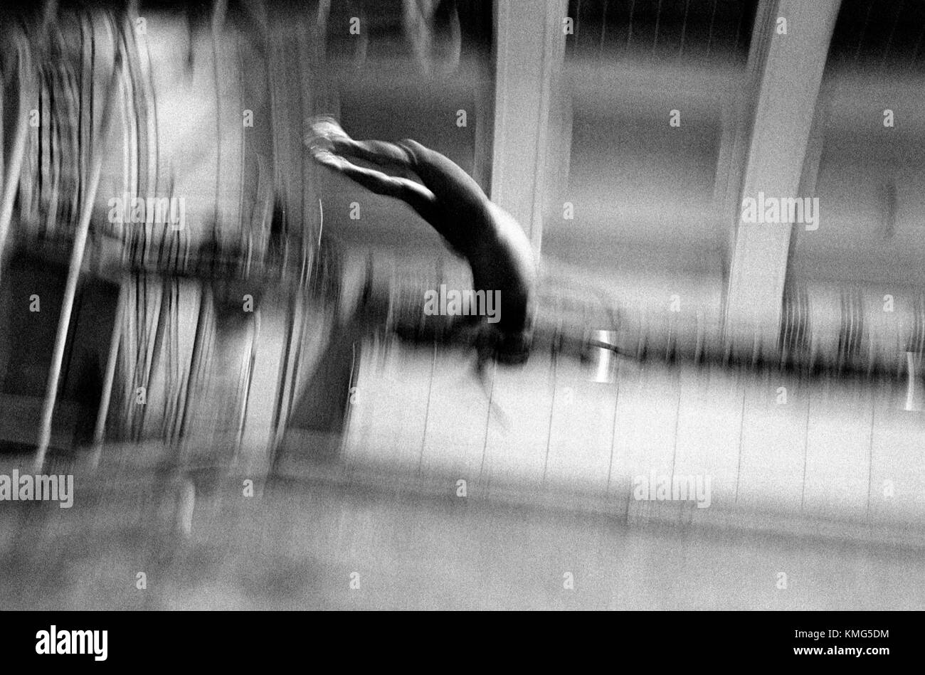Diving at an indoor swimming pool. THIS IS AN UPRIGHT PHOTOGRAPH     HOMER SYKES - Stock Image