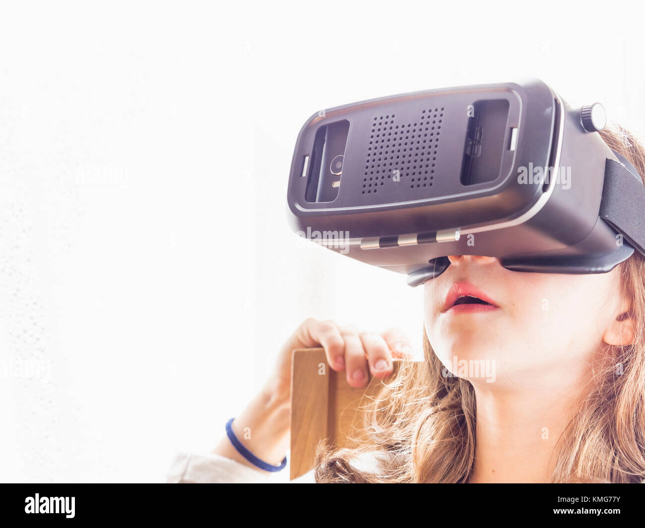 Girl wearing virtual reality glasses - Stock Image