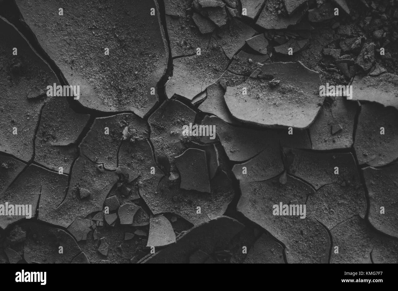 Black cracked mud. Beautiful background. - Stock Image