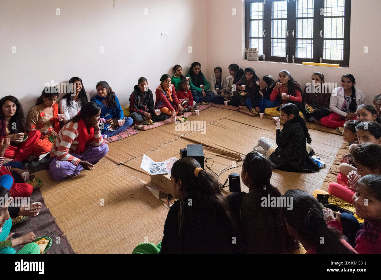 Young school going girls sitting together in a room for a meeting. - Stock Image