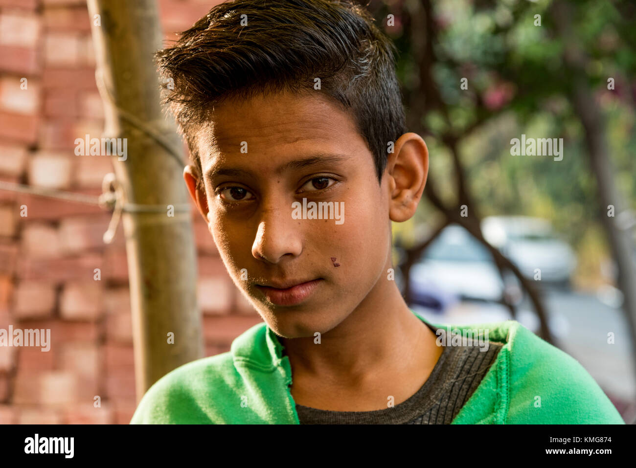 Portrait of a poor Indian boy. - Stock Image