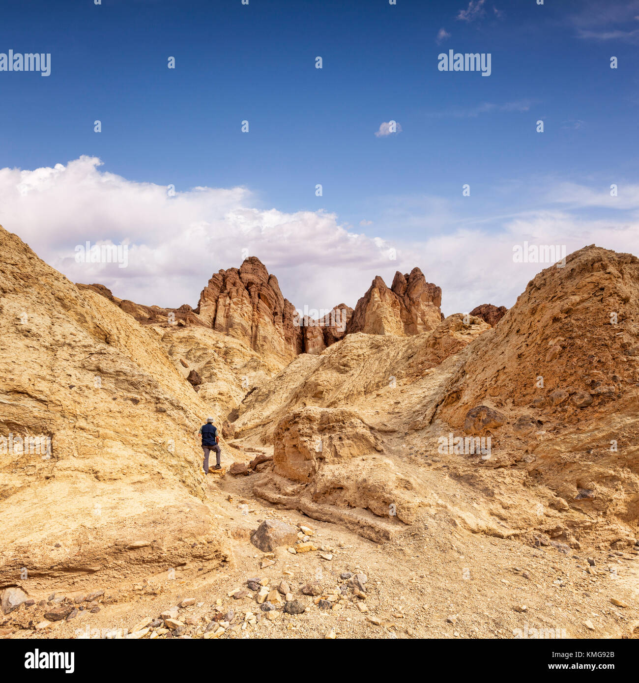 Senior man hiking the trail in Golden Canyon, Death Valley, USA. - Stock Image