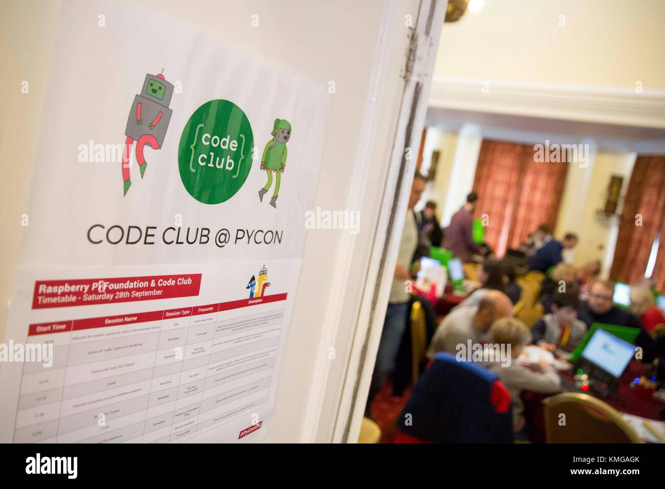 Code Club poster on the door of a room of young people and adults coding at a conference. - Stock Image